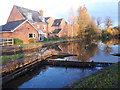 SJ7659 : Small weir at lock 62, Trent and Mersey Canal by Stephen Craven