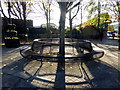 H4572 : Circular seat and shadows, Omagh by Kenneth  Allen