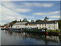 NS5867 : Buildings and boats at Old Basin by Stephen Craven