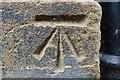 NZ2564 : Cut Bench Mark, Carliol Square by Mark Anderson