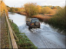 TL4279 : Driving through the flood water at Sutton Gault - The Ouse Washes by Richard Humphrey