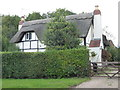 SO8756 : A thatched house in Worcester by Chris Allen