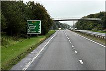 NS3335 : Footbridge over the A78 near Meadowhead Industrial Estate by David Dixon