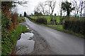H4763 : Water lying along Letfern Road by Kenneth  Allen