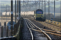 NT9953 : A freight train on the Royal Border Bridge by Walter Baxter
