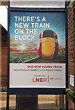 NT9953 : A train poster at Berwick Railway Station by Walter Baxter