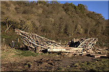 NT9953 : A wooden boat sculpture by the River Tweed by Walter Baxter