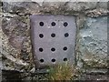 SH6268 : A slate ventilation grille at church, Llanllechid by Meirion