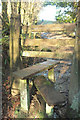 SX7579 : Dangerous stile near Leighon Lodge by Derek Harper