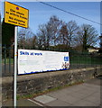 ST2985 : Skills at Work banner on railings at the edge of Tredegar Park, Newport by Jaggery
