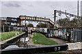 SJ8746 : Messy Crossings, lock 37 and Mile Marker 56-36, Trent Mersey Canal by Brian Deegan