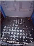 SH6266 : A debris covered tiled former shop doorway on the High Street, Bethesda by Meirion