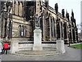 NZ2464 : War memorial at St Thomas's church by Robert Graham