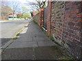 SJ2188 : Barton Road, Hoylake, and a bench mark by John S Turner