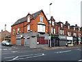 SE2734 : Shops on Kirkstall Road (corner of Haddon Road) by Stephen Craven
