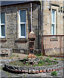 NS3154 : Cast iron milepost, Kilbirnie by Thomas Nugent