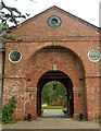 SO5476 : Carriage entry, Stable block, Henley Hall by Derek Harper