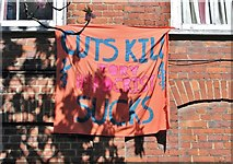 TG2309 : St Saviours Alley - Cuts Kill banner by Evelyn Simak
