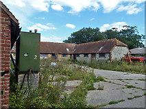 SU8518 : Older farm buildings around yard, Church Farm, Bepton by Robin Webster