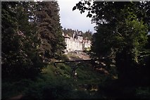 NU0702 : Cragside (NT) and footbridge near Rothbury by Colin Park