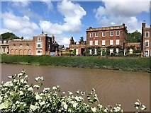 TF4509 : The River Nene and Peckover House in Wisbech by Richard Humphrey