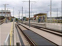 SJ7996 : Village Tram Stop, Trafford Park by David Dixon