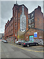 SJ8498 : Cable Street - Artwork on the Swan Buildings by David Dixon