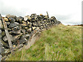 SE0945 : Corner of a boundary wall on High Moor by Stephen Craven