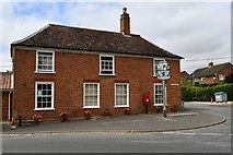 TM3464 : Rendham: 'The Corner House' and village sign by Michael Garlick