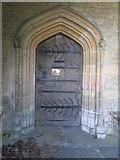 SP9599 : Church of St. John the Baptist, Wakerley, north door by Jonathan Thacker