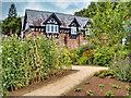 SJ8383 : Quarry Bank Mill, Upper Garden and Gardener's Cottage by David Dixon