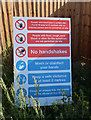 TL2569 : Covid safety notice by construction site entrance by Hugh Venables