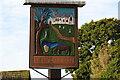 TG2902 : Yelverton village sign by Adrian S Pye
