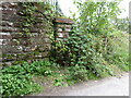 NY5030 : Railway bridge wing wall, Thacka Lane by Adrian Taylor