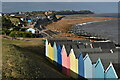 TM3235 : Beach huts and the beach at Old Felixstowe by Simon Mortimer