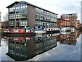 SO8554 : Apartments reflected in the canal at Diglis by Philip Halling