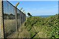 TM3438 : Perimeter fence at RAF Bawdsey by Simon Mortimer