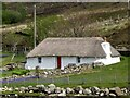 NG5627 : Thatched crofters cottage in Luib by Marika Reinholds