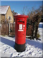TF1505 : EIIR postbox at Glinton Post Office in the snow by Paul Bryan