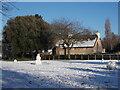 TF1606 : Peakirk village green in the snow by Paul Bryan