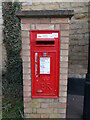 TF1308 : Wall-mounted EIIR postbox on High Street, Maxey by Paul Bryan