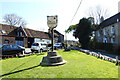 TL8093 : Mundford village sign by Adrian S Pye