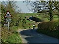 SE3248 : Cyclists on Barrowby Lane by Stephen Craven