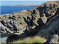 NJ5767 : Natural arch near Redhythe Point by Nigel Feilden