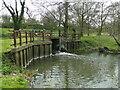 TM1877 : Sluice gate releasing water into the River Waveney by Adrian S Pye