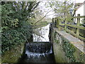 TM2481 : Weybread water mill. wheel site and sluice by Adrian S Pye