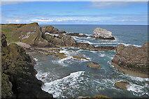 NJ4968 : Rocky Coast by Anne Burgess