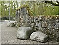 NS5574 : Boulders beside the wall by Richard Sutcliffe