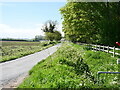 TG3334 : Minor rural Road approaching rear of Bacton Gas distribution Station by David Pashley