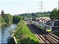SE2535 : Kayakers and local train at Kirkstall Bridge by Stephen Craven